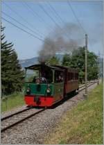 115-blonay-8211-chamby/347282/dampftram-g22-n176-4-rimini-1900 Dampftram G2/2 N° 4 'Rimini' (1900) mit einem NStCM Wagen auf kurz vor Chaulin. (Blonay - Chamby Pingstfestival) 9. Juni 2014